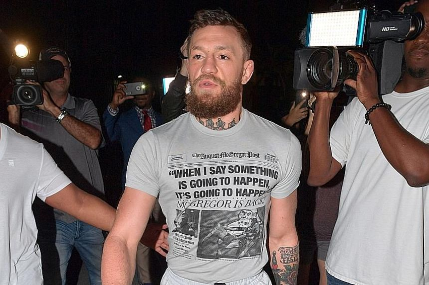 Conor McGregor walking out of the Turner Guilford Knight Correctional Centre after his release, following his arrest for smashing the phone of a fan who tried to take pictures of the mixed martial arts fighter early Monday morning.