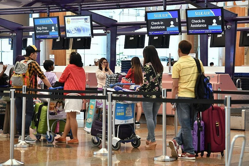SilkAir passengers at Changi Airport Terminal 2 yesterday. The airline, which has six Boeing 737 Max 8 jets, is one of those at Changi affected by the temporary suspension. The Civil Aviation Authority of Singapore said it was suspending the aircraft