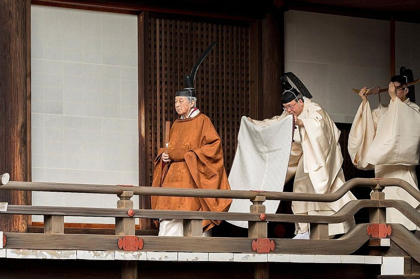Emperor Akihito visiting the Imperial Palace yesterday for a ritual in which he announced his abdication to his ancestors and deities.