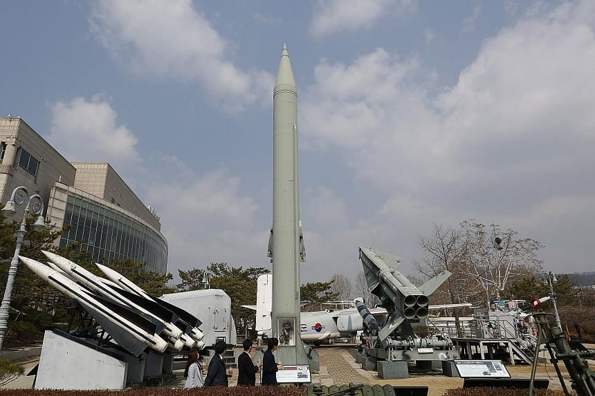 Visitors at the Korean War Memorial Museum in Seoul looking at a North Korean missile. Dr Cheong Seong-chang of the Sejong Institute think-tank says the permanent shutdown of North Korea's main Yongbyon nuclear facility, offered in talks with the US
