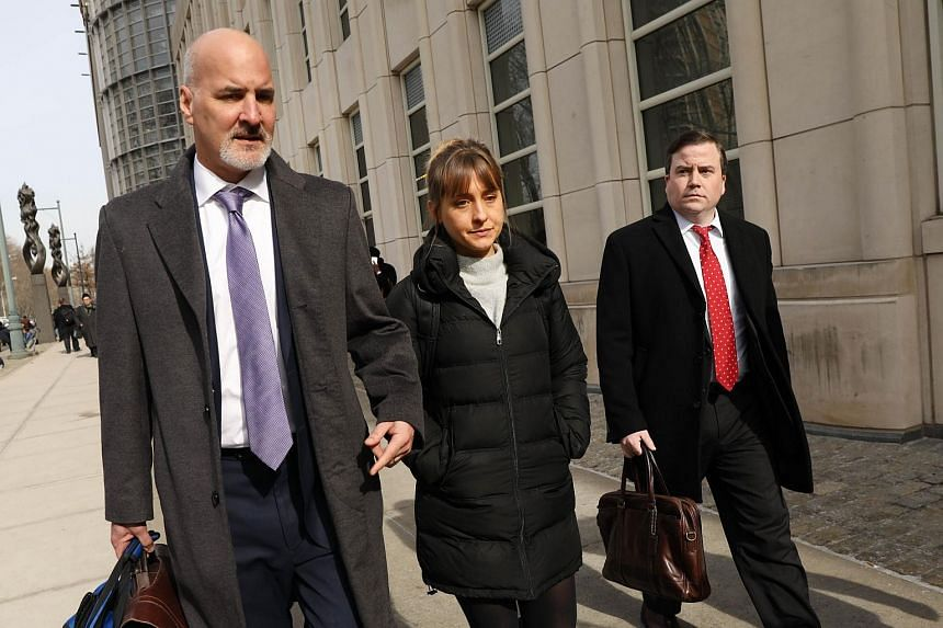 Actress Allison Mack leaving the Brooklyn Federal Courthouse with her lawyers after a court appearance in relation to Nxivm, on Feb 6, 2019.