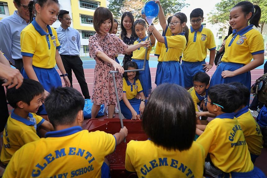Senior Minister of State for the Environment and Water Resources Amy Khor participating in a water-pipe game with Clementi Primary School pupils during the water-rationing exercise on March 13, 2019.
