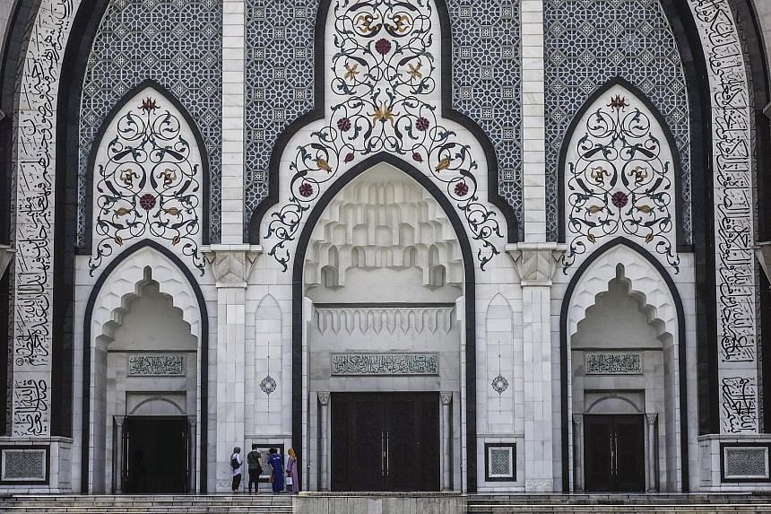 Tourists visiting a mosque in Kuala Lumpur, Malaysia. Sarawakian Alister Cogia pleaded guilty to uploading offensive materials on Islam on social media.