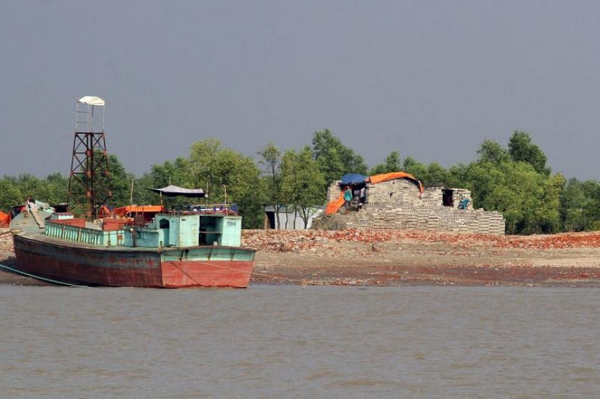 Shelters and flood walls have been constructed on Bhashan Char, a muddy silt islet that only rose from the Bay of Bengal in 2006, in the hope of shifting 100,000 Rohingya refugees there.