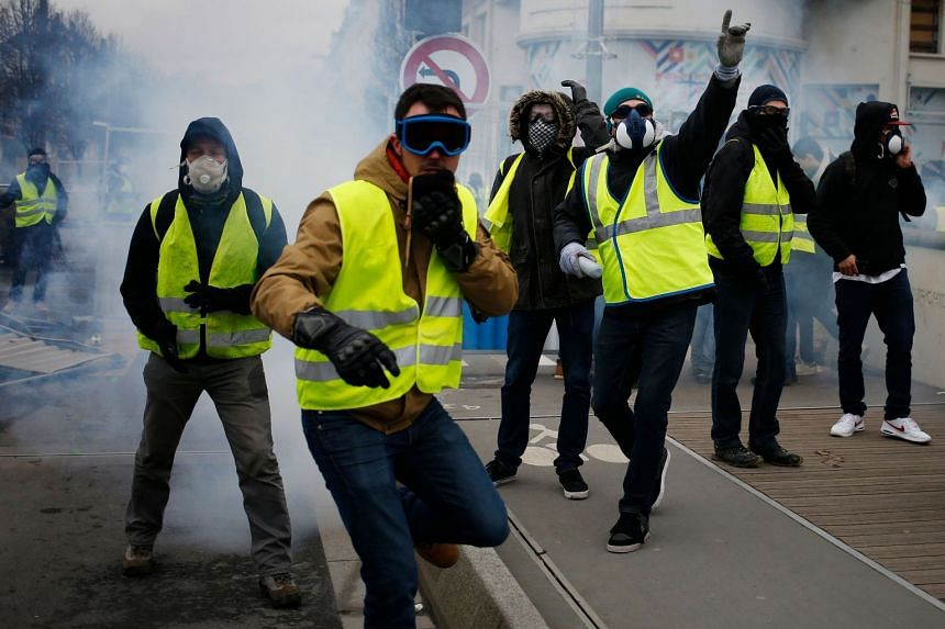 """Anti-government """"yellow vest"""" protesters clash with police in January 2019 in Caen, northwestern France."""