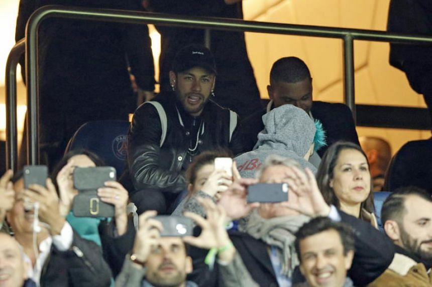 Paris Saint Germain's Neymar in the stands during the Champions League round of 16 match between PSG and Manchester United at the Parc des Princes Stadium in Paris on March 6, 2019.