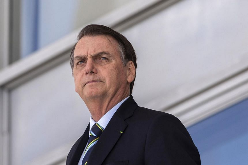 Brazil's President Jair Bolsonaro attending a welcome ceremony at the Planalto palace in Brasilia, on March 12, 2019.