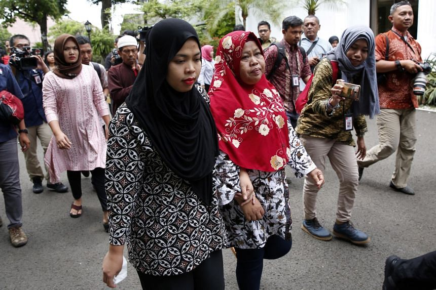 Siti Aisyah and her mother walking to the Presidential Palace in Jakarta, Indonesia, on March 12, 2019.