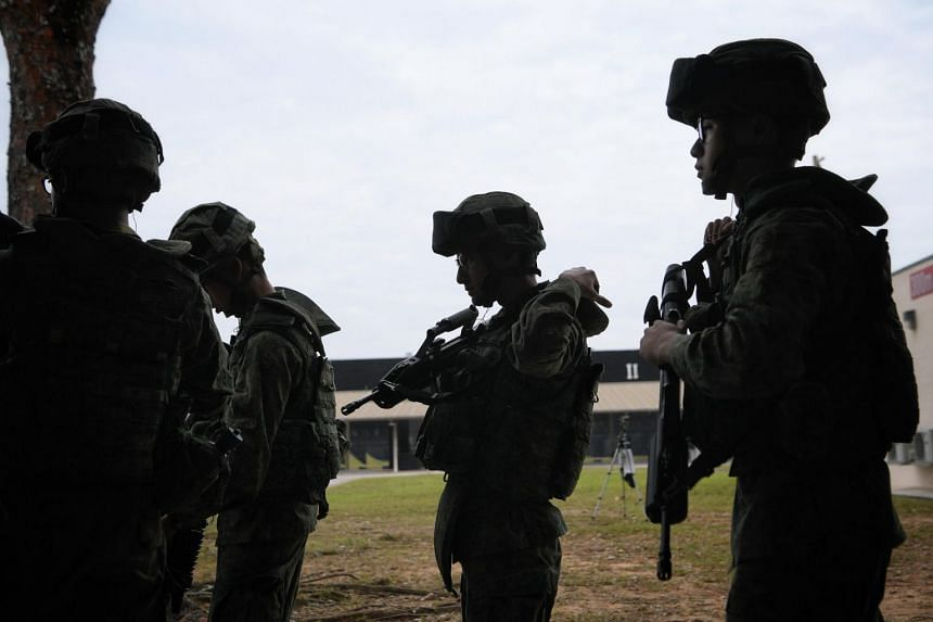 Soldiers in action at Pasir Laba Camp's shooting range, on Feb 28, 2019.