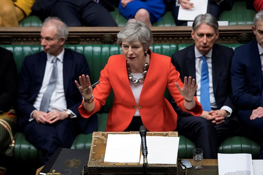 Britain's PM Theresa May speaks in Parliament in London, Britain, on March 12, 2019.
