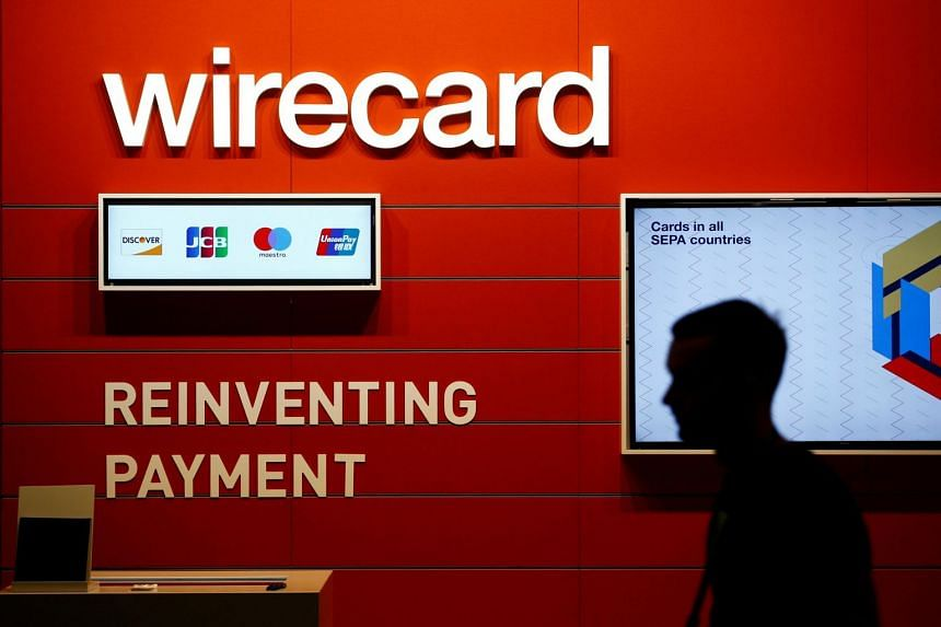 A man walks past a Wirecard booth at an event in Cologne, Germany, on Aug 22, 2018.