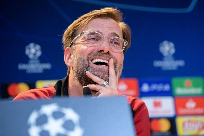 Klopp smiles during a press conference ahead of the match.
