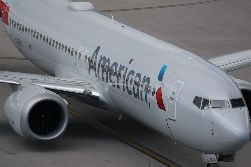 An American Airlines Boeing 737 Max 8 is seen taxiing to its gate at Miami International Airport.