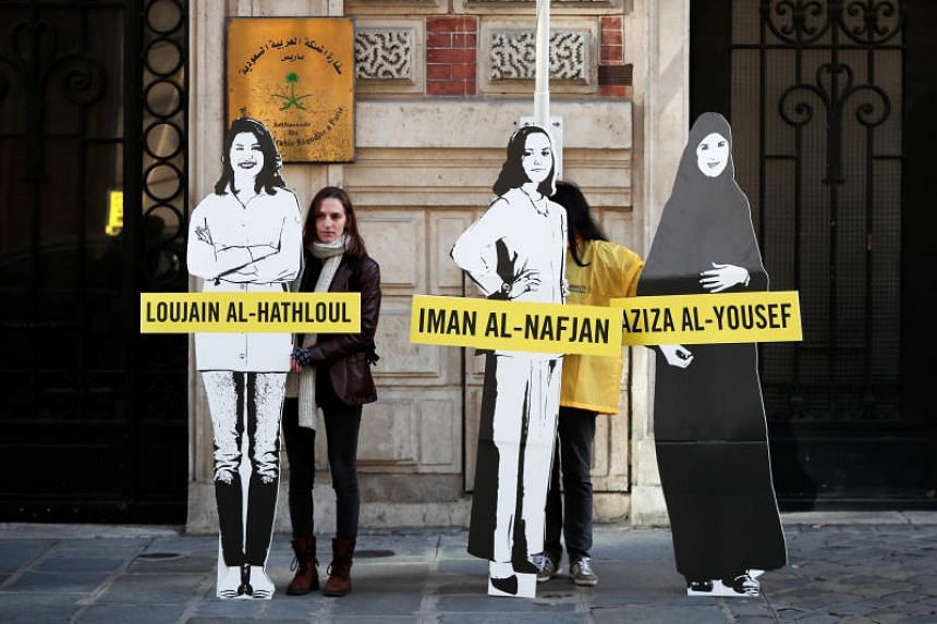 Demonstrators from Amnesty International protest to urge Saudi authorities to release jailed women's rights activists Loujain al-Hathloul, Eman al-Nafjan and Aziza al-Yousef outside the Saudi Arabian Embassy in Paris on March 8, 2019.
