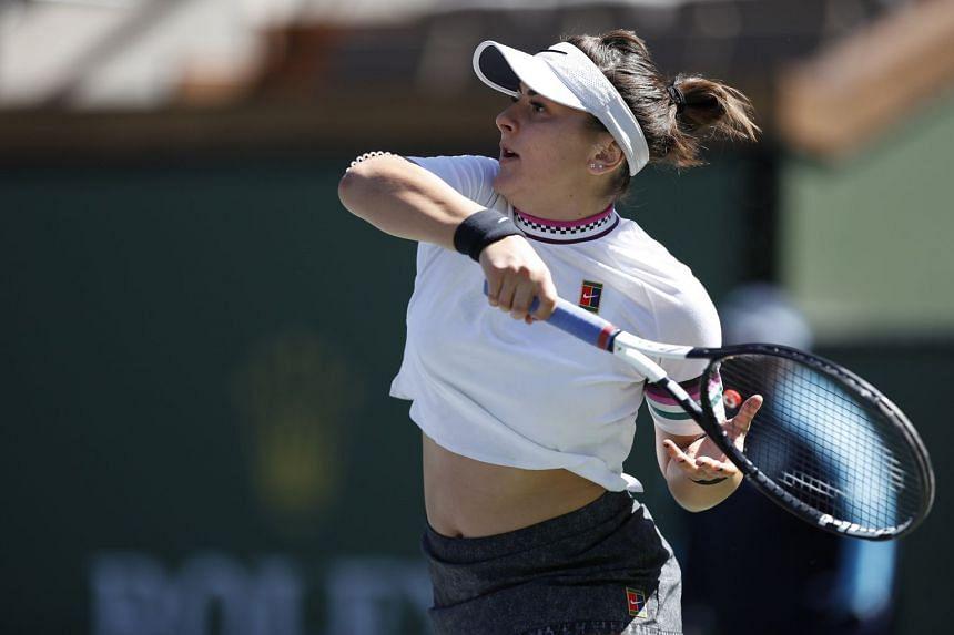 Bianca Andreescu of Canada in action against Garbine Muguruza of Spain.