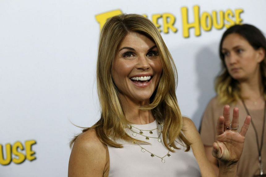 Cast member Lori Loughlin poses at the premiere for the Netflix television series Fuller House in 2016.