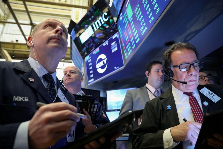 Traders work on the floor at the New York Stock Exchange, March 13, 2019.
