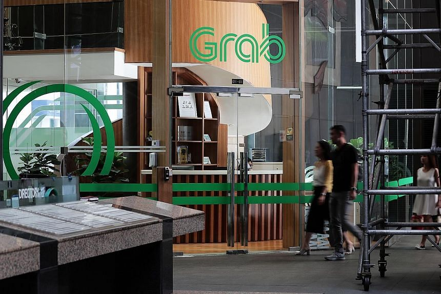 The Grab office in Cecil Street. The loan process takes two minutes and can be done online. Firms whose loan applications are successful can receive the money in three days.