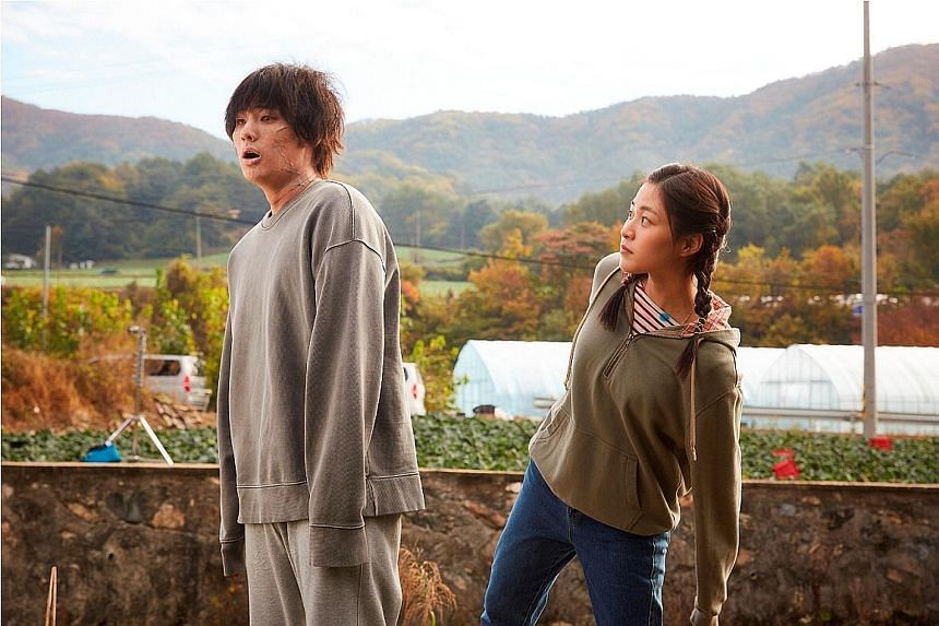 The Odd Family: Zombie On Sale stars (both right) Jung Ga-ram as a harmless zombie and Lee Soo-kyung, who takes a liking to him.