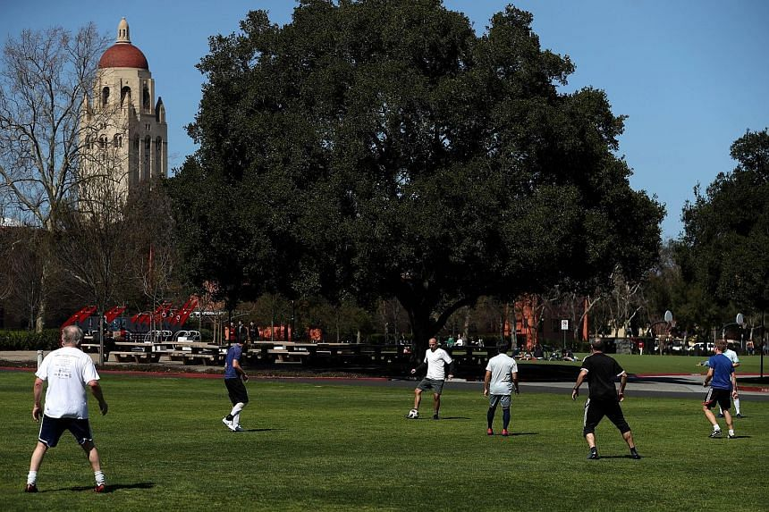 People playing football at Stanford University earlier this week. The university is among top schools named in the US Justice Department's largest-ever college admissions prosecution, resulting in charges against 50 people.