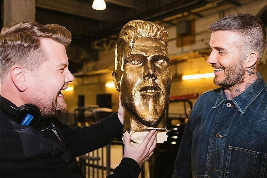 """CORDEN PRANKS BECKHAM: David Beckham (left) waved the red card when an ugly statue of him was unveiled. """"I really don't see how this can go out, it's embarrassing,"""" the former Manchester United player said in panic. He had turned up on Monday at so"""