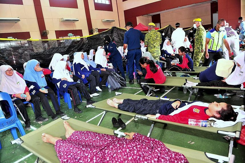 Students from two schools in the Pasir Gudang area were taken to Taman Pasir Putih Community Hall for treatment after experiencing breathing difficulties. The authorities said the chemical waste was discharged into Sungai Kim Kim, which flows into th