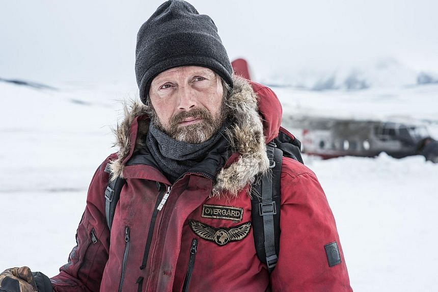 Overgard (played by Mads Mikkelsen) stays alive in Arctic with his survival skills.