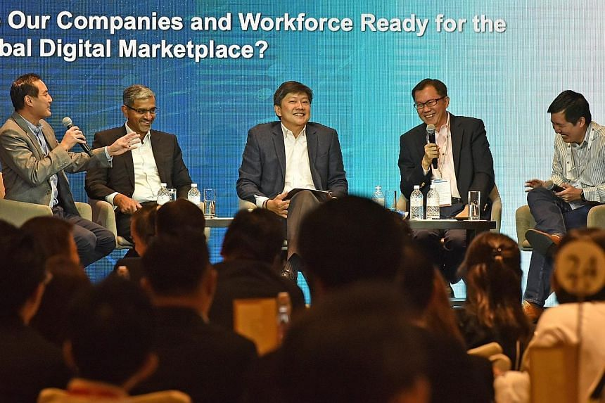At yesterday's panel discussion were (from left) Mr Tan Kiat How, chief executive of the Info-communications Media Development Authority; Mr Abraham Thomas, managing director of IBM Singapore; Mr Ng Chee Meng, Minister in the Prime Minister's Office