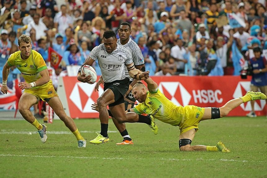 Fiji's Amenoni Nasilasila skipping past Australia's Tom Connor in the HSBC Singapore Rugby Sevens final at the National Stadium last April. Olympic champions Fiji scored a last-gasp try to emerge 28-22 winners.