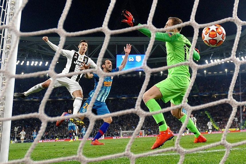 Cristiano Ronaldo heading in Juventus' opener against Atletico Madrid at the Allianz Stadium in Turin. The Italian giants overturned a 2-0 first-leg deficit to win 3-2 on aggregate.
