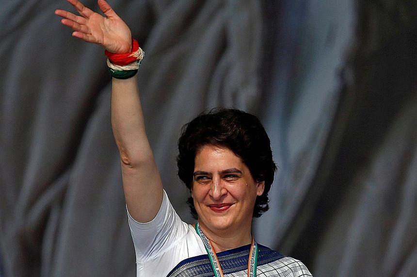 Above: Mrs Priyanka Gandhi Vadra of the Congress party campaigning in Gujarat earlier this week. Left: The site (building with an arch) where the party used to have its office in Gorakhpur, Uttar Pradesh. Mrs Vadra is in charge of the party's electio