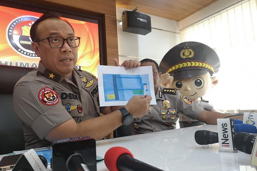 Police spokesman Brigadier General Dedi Prasetyo shows a map of the terrorist's house in Sibolga, North Sumatra, where police found 300kg of explosive and more than 15 bombs.