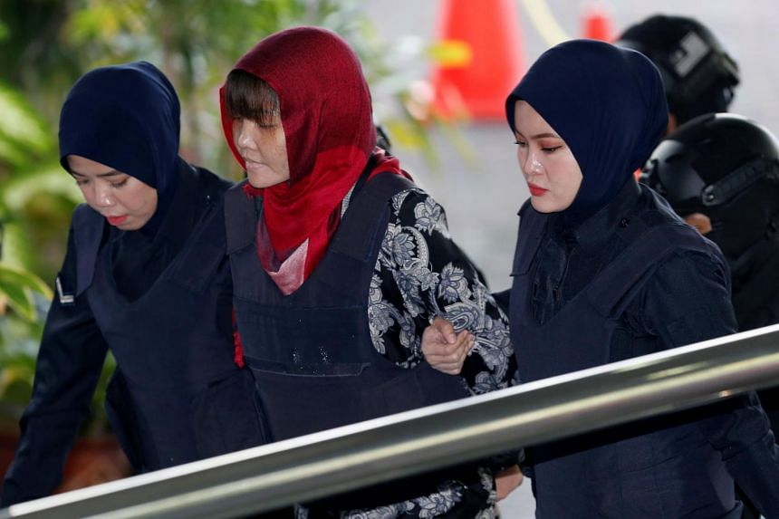 Doan Thi Huong (in red headscarf) has asked the Malaysian government to withdraw the murder charge against her.