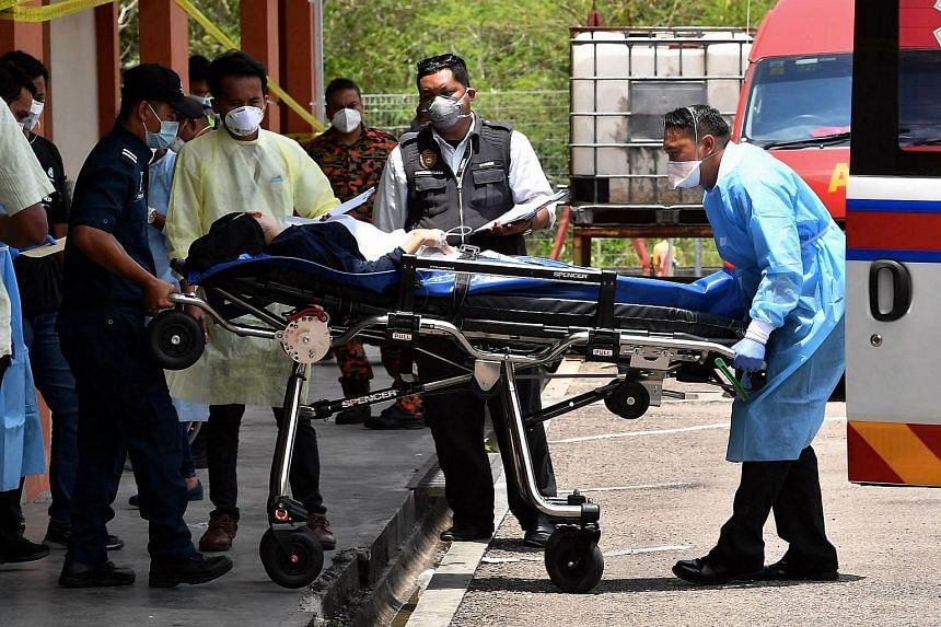 Medical personnel sending a student who was affected by toxic fumes in Pasir Gudang to hospital on March 13, 2019.