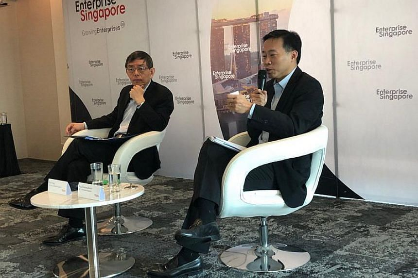 Enterprise Singapore chairman Peter Ong (left) and chief executive Png Cheong Boon at the agency's year-in-review conference on March 14. The agency was formed in April 2018 to help companies here grow their capabilities and venture overseas.