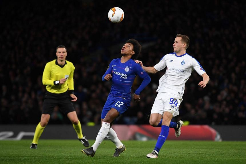 Chelsea's Willian (left) vies for the ball with Dynamo Kiev's Tomasz Kedziora during the Uefa Europa League round of 16 first leg soccer match Chelsea and Dynamo Kiev in London, on March 7, 2019.