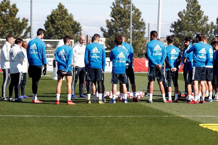 A handout photo made available by Real Madrid of their new head coach Zinedine Zidane (sixth from left) leading his first training session after his appointment at Valdebebas sport complex, outside Madrid, on March 13, 2019.