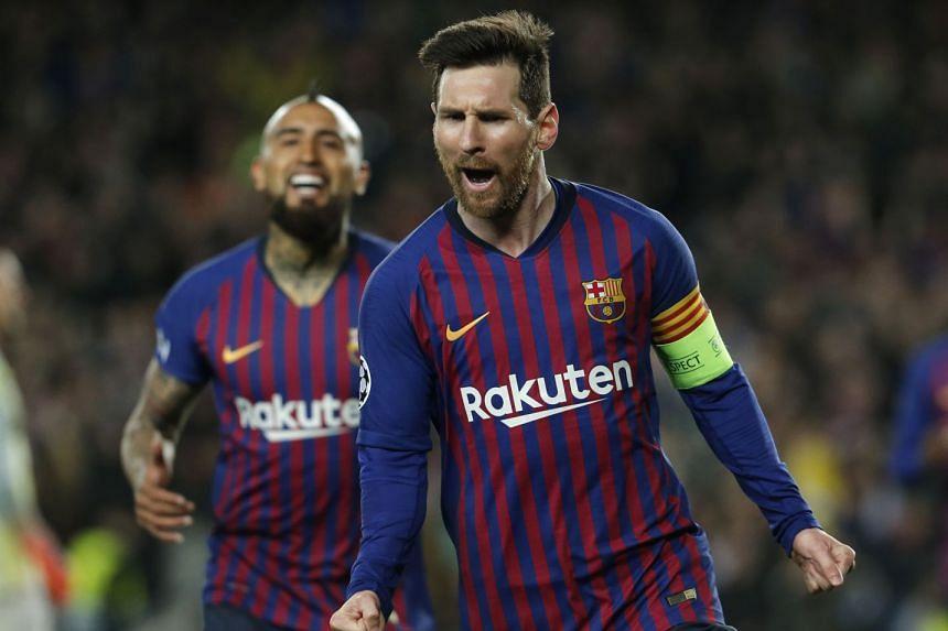 Messi celebrates after scoring.