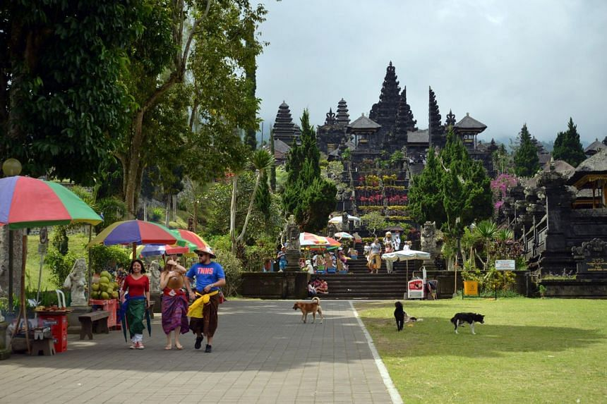 Tourists near Pura Besakih, a Hindu temple in Bali, in 2016.