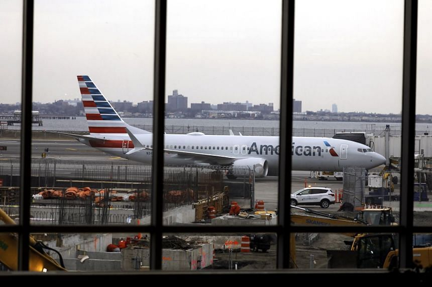 An American Airlines Boeing 737 Max 8 parked at LaGuardia Airport in New York, on March 13, 2019.