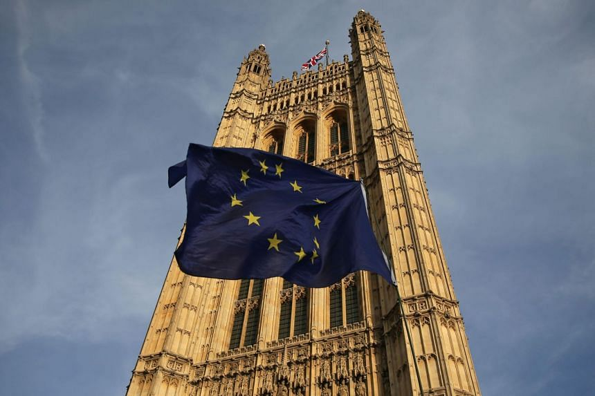 A European Union flag flutters in front of London's Victoria Tower, on Feb 13, 2019.