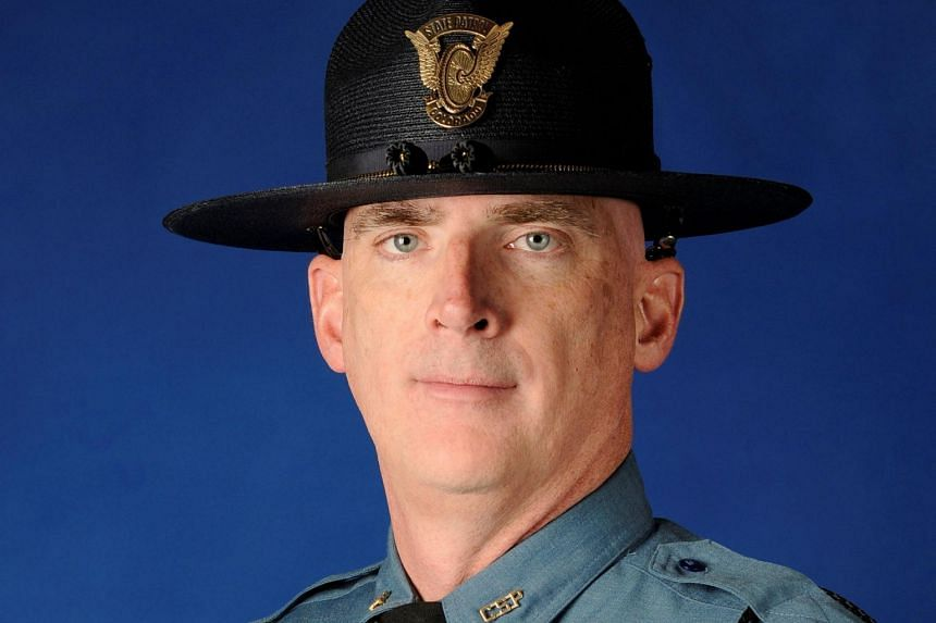 The Colorado State Patrol said Corporal Daniel Groves was struck by a car that veered out of control and died of his injuries.