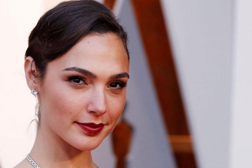 """Gal Gadot (pictured) lauded Brie Larson's outing as Captain Marvel in an online post, writing: """"I'm so happy for you sister! congrats."""""""