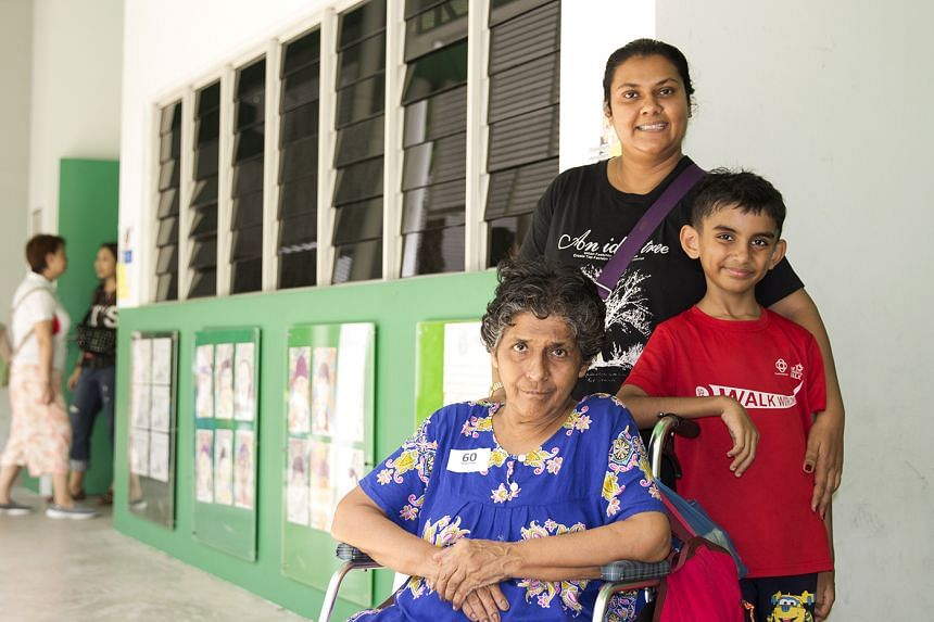 Madam Chandreka, 68, was accompanied by her daughter Anita Davi and grandson Krishang during her functional screening at New Town Primary School. PHOTO: MOH