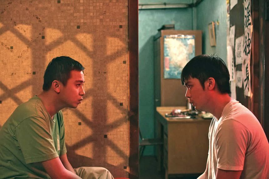 Didi (played by Ernest Chong, above left) puts his life on hold to look after his older autistic brother, Wen Guang (played by Kyo Chen), in Guang.