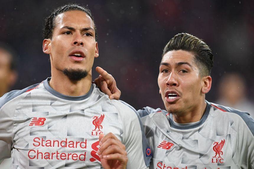 Liverpool's Virgil van Dijk (left) celebrates scoring his side's second goal with team mate Roberto Firmino.