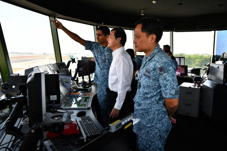 (From left) Commander of Air Defence Task Force Brigadier General Gaurav Keerthi briefing Senior Minister of State for Defence Heng Chee How, with Chief of Air Force Major-General Mervyn Tan at his side, in the RSAF air traffic control tower at Chang