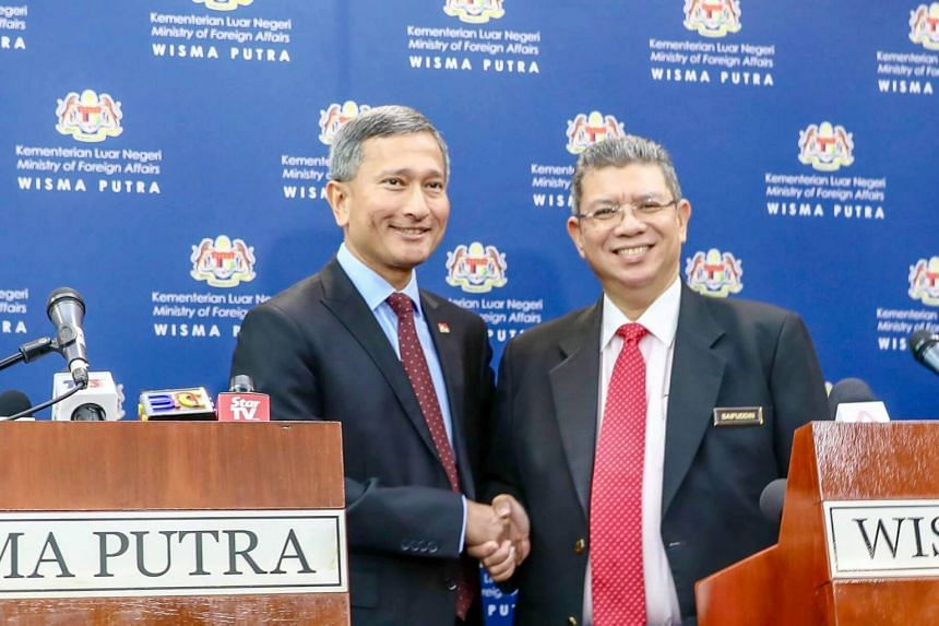 Singapore's Foreign Minister Vivian Balakrishnan and his Malaysian counterpart Saifuddin Abdullah agreed to jointly suspend overlapping port claims in the waters off Tuas with immediate effect.