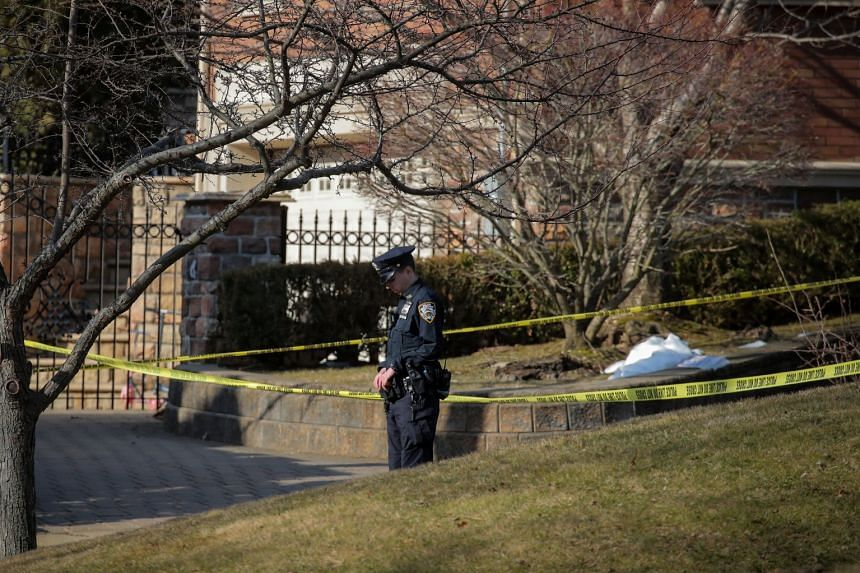 A police officer is seen at the scene of the shooting.