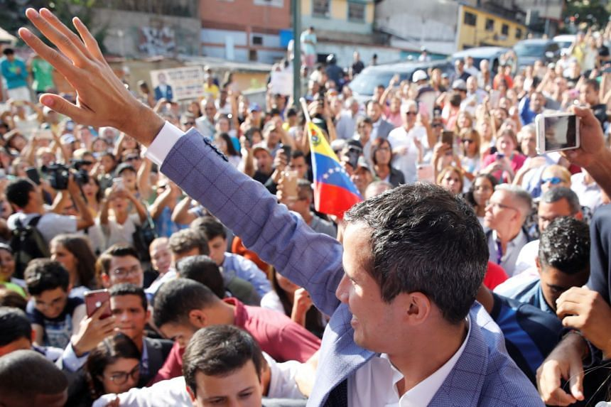Venezuelan opposition leader Juan Guaido attends a rally against President Nicolas Maduro's government in Caracas.